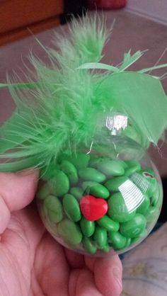 Handmade Christmas ornament. The Grinch Green Ornament with a heart that is too small. M&M's Grinch ornament with a tiny heart.