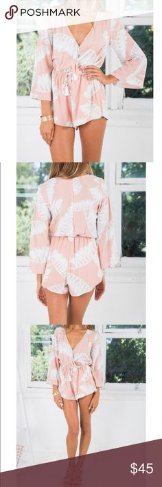 White fox boutique Castaway Romper Blush Print XS Brand with new tags never worn White Fox Boutique Castaway Romper Blush Print size XS. Shipping from this website was $12 so the price of this romper was really around $65 white fox boutique Pants Jumpsuits & Rompers