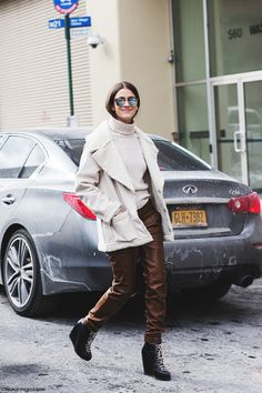 New_York_Fashion_Week-Fall_Winter_2015-Street_Style-NYFW-Amanda_Weiner-White_Coat-Brown_Trousers-Wedges_Boots-