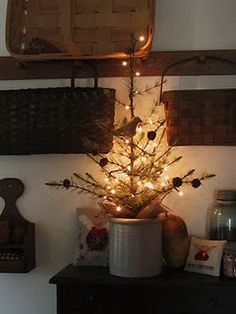 Any little tree would work in this cute little crock.  If too deep, put a small bowl upside down in it to build it up or a small box to bring tree up higher.