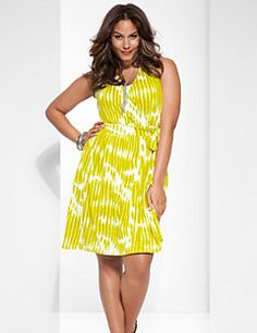 A sassy look for sunny days, our sleeveless wrap dress puts the spotlight on all your best features with a curve-flattering shape. In a bright print for plenty of personality, this haute number features a surplice neckline with side-tie closure at the waist and pleated shoulder detailing. Work it at the office, or punch it up for weekend occasions.