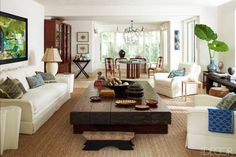 House Tour: A Dominican Republic Retreat - ELLE DECOR-Great way to fill up a large living room.a big wood table Living Room Sofa, Interior Design Living Room, Living Room Designs, Living Spaces, Elle Decor, British Colonial Decor, Modern Loft, Modern Contemporary, Great Rooms