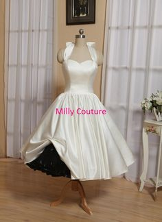 Our dresses are made of luxury import satin, fully lined, 9 bones in the bodice and chest pad in the bust, lace up back or zipper back are all
