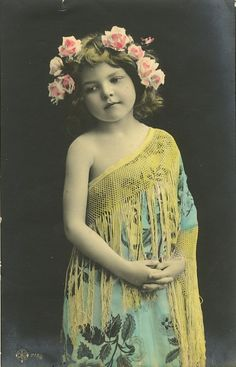 1909 Adorable little girl with flowers in her hair tinted postcard