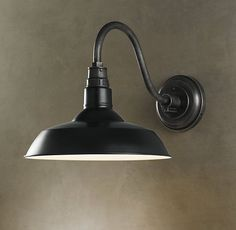 Restoration Hardware's Vintage Barn Sconce for over the kitchen sink.