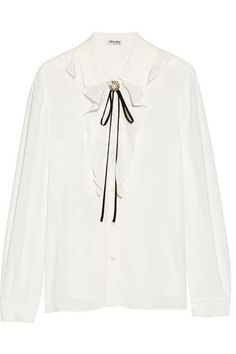 Miu Miu's blouse is made from fluid crepe with a beautiful loose drape. Trimmed with ruffled silk, this Western-inspired piece has a faux-pearl and crystal-embellished brooch and contrasting black ties. Layer yours over a turtleneck sweater to temper its lightweight feel.