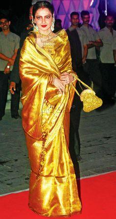 Rekha in a shimmering gold sari Rekha Saree, Sabyasachi Sarees, Kanjivaram Sarees, Bollywood Sarees Online, Bollywood Designer Sarees, Indian Bridal Sarees, Bridal Silk Saree, Indian Fashion Trends, India Fashion