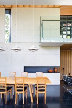 Taringa House by Loucas Zahos Architects   A library looks over the dining area.