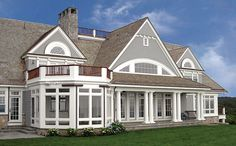 back of New England shingle:  eyebrow windows; screened porch; lawn