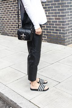 Charlie wears baggy leather trousers from her collection with Rag & Bone top, Adidas slides and Givenchy bag. Adidas Slides Outfit, Adidas Sandals, Sport Sandals, Mode Adidas, Moda Fashion, Womens Fashion, Grunge, Fashion Gone Rouge, Athleisure Trend