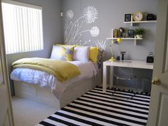 A color scheme of sunny yellow and soft gray are oh-so-stylish for a hip teen, while underbed drawers and floating shelves keep this bedroom spic and span. Design by Rate My Space user dodi.