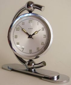 """German Art Deco Chrome-Plated, 8 Day Mechanical, Swiveling Shelf Clock 