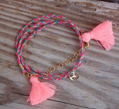 Bonk Ibiza bracelet with tassels and peace charm.