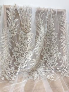 Items similar to Luxury heavily beaded silver tube off white tulle bridal lace fabric, haute couture wedding gown prom dress fabric on Etsy Couture Wedding Gowns, Bridal Gowns, Flower Girl Dresses, Prom Dresses, Wedding Dresses, Bridal Lace Fabric, Wedding Dress Boutiques, Wedding Belts, White Tulle