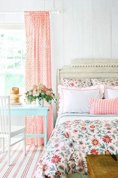 A playful bedspread (Tatiana by Kathryn M. Ireland) provides an easy jumping off point to inspire other design elements