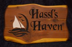 Cedar Sign Hassl's Haven  18 Inch Cedar Slab Sign Sailboat Scene Black Chancery Font | Cedar Signs by CedarSlabSigns.com Lake House Signs, Cabin Signs, Cottage Signs, Lake Signs, Property Signs, Camper Signs, Personalized Signs, Sailboat, Wood Signs