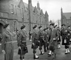 DonaldCameron of Lochiel, 26th Chief, inspecting the Passing-out Parade of the 15th intake of recruits at the Regimental Depot at Cameron Barracks in 1954.