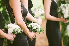 Black Bridesmaids White Bouquets | photography by http://rebeccaarthurs.com