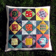square-in-square pillow | Flickr - Photo Sharing, the fabrics are so interesting - love this