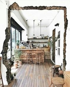 The texture of the entry way and the dark color contrast he normal and clean kitchen.