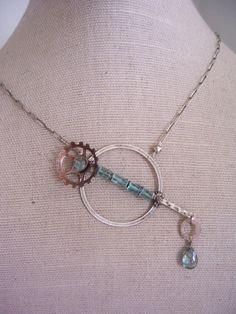 Asymmetrical Steampunk necklace  Aqua blue  by dnajewelrydesigns