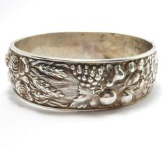 ORNATE REPOUSSE FLORAL SILVER PORTUGAL BANGLE