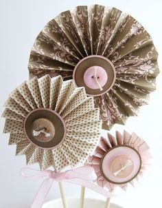 @Dana Kent LOOK!! Heather shows how to make the accordian flowers so they won't fall apart. :)
