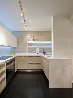 This small, minimalist kitchen is utilitarian yet polished with simple, clean lines. Design by http://www.formaonline.com/home/index.shtml