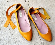 Gold yellow ballet flats with ankle ties