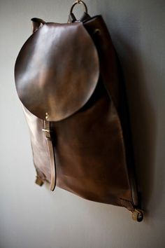 I don't know what it is but I like the way it looks. : satchel, backpack, bag, leather, brass, craftsmanship