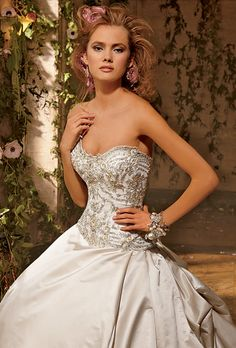 Brides: Eve of Milady. Also available in White with Silver embroidery and accented with flowers.