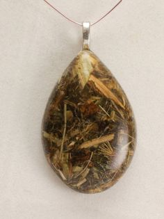 Holy Blessed Thistle herb in Resin Pendant by GreyGyrl on Etsy, $12.00