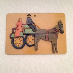Beautiful Irish 2D wood art plaque featuring a man and a woman in a horse drawn wagon. Highly skilled, yet simple in composition and style. Folk art at its best!