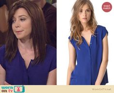 Lily's blue short sleeved button front top on How I Met Your Mother. Outfit Details: http://wornontv.net/20644 #HowIMetYourMother #CBS