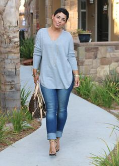 Mimi G. In an oversized sweater and oversized cuffs