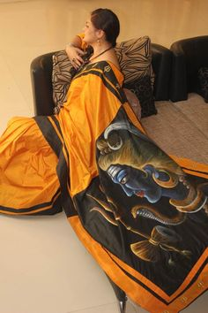Silk saree in the warm and rich colors of Mustard with hand painted Lord Shiva. This saree is not for the faint hearted <3