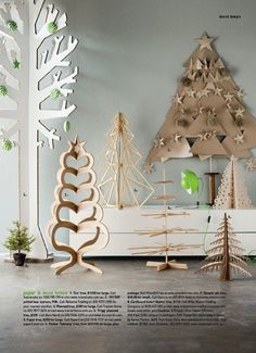 paper + wood trees / styling by vanessa colyer tay and photography by sam mcadam / via blog.piajanebijke...
