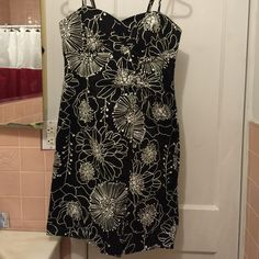 AGB black/white floral dress Knee length spaghetti strap dress. Floral pattern has zipper in back and ties at the top. Never worn. No rips or stains. AGB Dresses
