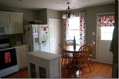 hardwood floors, pale cabinets, warm grey walls, funky curtains
