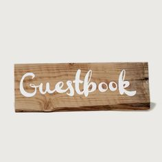 """guestbook"" sign: Hand painted ""guestbook"" sign on rustic reclaimed wood."