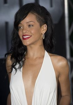 Rihanna is always known for her edgy style and hair choices. She is currently seen rocking a half shaved head.