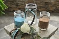 Unity sand ceremony with mason jars. This is great todo with the kids to incorporate them into the ceremony.
