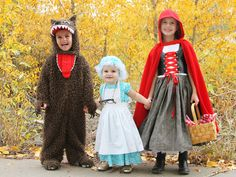 Little Red Riding Hood - We love how story time has turned into costume time for these three little kids. Each plays a major role — Granny, Little Red, and the Big Bad Wolf — and Red's picnic basket is the perfect place to store scores of candy. 11 Scary-Good Themed Costume Ideas