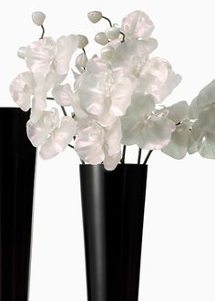 $8.99 27IN BUTTERFLY ORCHID SPRAY  THIS ARTIFICIAL BUTTERFLY ORCHID SPRAY HAS AN ALL OVER PEARL LOOK IN ITS FLOWERS AND IS ACCENTED WITH A LIGHT PINK IRIDESCENCE. ABOUT 5 SPRAYS ARE SHOWN HERE IN OUR BLACK GLASS TRUMPET VASE. PLASTIC FLOWERS ON A DARK GREEN, WIRED STEM.