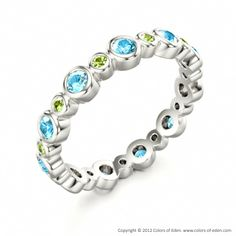 ORBIT   Designer Eternity Ring with Peridot and Blue Zircon in 18k White Gold