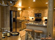 The kitchen in Golden Eagle's Modified Northern Eagle plan. Dining Area, Kitchen Dining, Kitchen Island, Timber House, Log Cabin Homes, Cozy Cabin, Home Pictures, Home Photo
