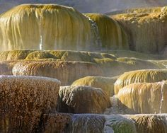 Hot water pouring over large travertine structures | Mammoth Hot Springs, Yellowstone