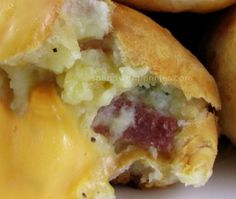 Loaded Mashed Potato Bombs - the biscuits are rolled out, they create a light crispy crust to hold the cheese, mashed potatoes, bacon and chives...