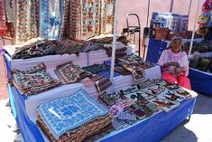 Otomi woman selling traditional Otomi embroidered cloths in Tequisquiapan.