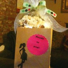 """Ready to pop"" baby shower favors. Brown paper bag with popcorn in it, then decorate. Cute and inexpensive"
